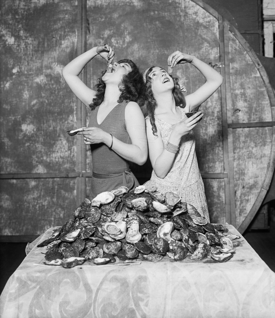 Here are Lois and Ruth Waddell of the follies, who at a single sitting devoured 204 oysters betweenthem - equally divided of course. The girls were judged the winners in the great oyster eating contest held amng the members of the follies company. BPA2 #839 --- Image by © Bettmann/CORBIS